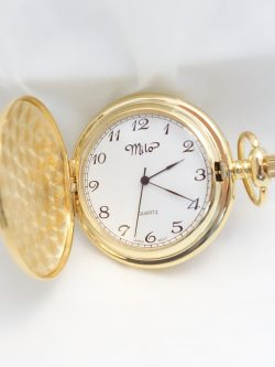 yellow toned pocket watch