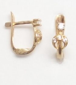 19k baby earrings with white stones side view