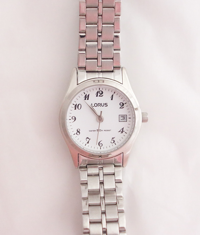 ladies lorus silver toned bracelet watch