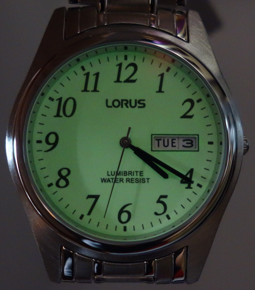 mens lorus lumibrite silver toned watch dark