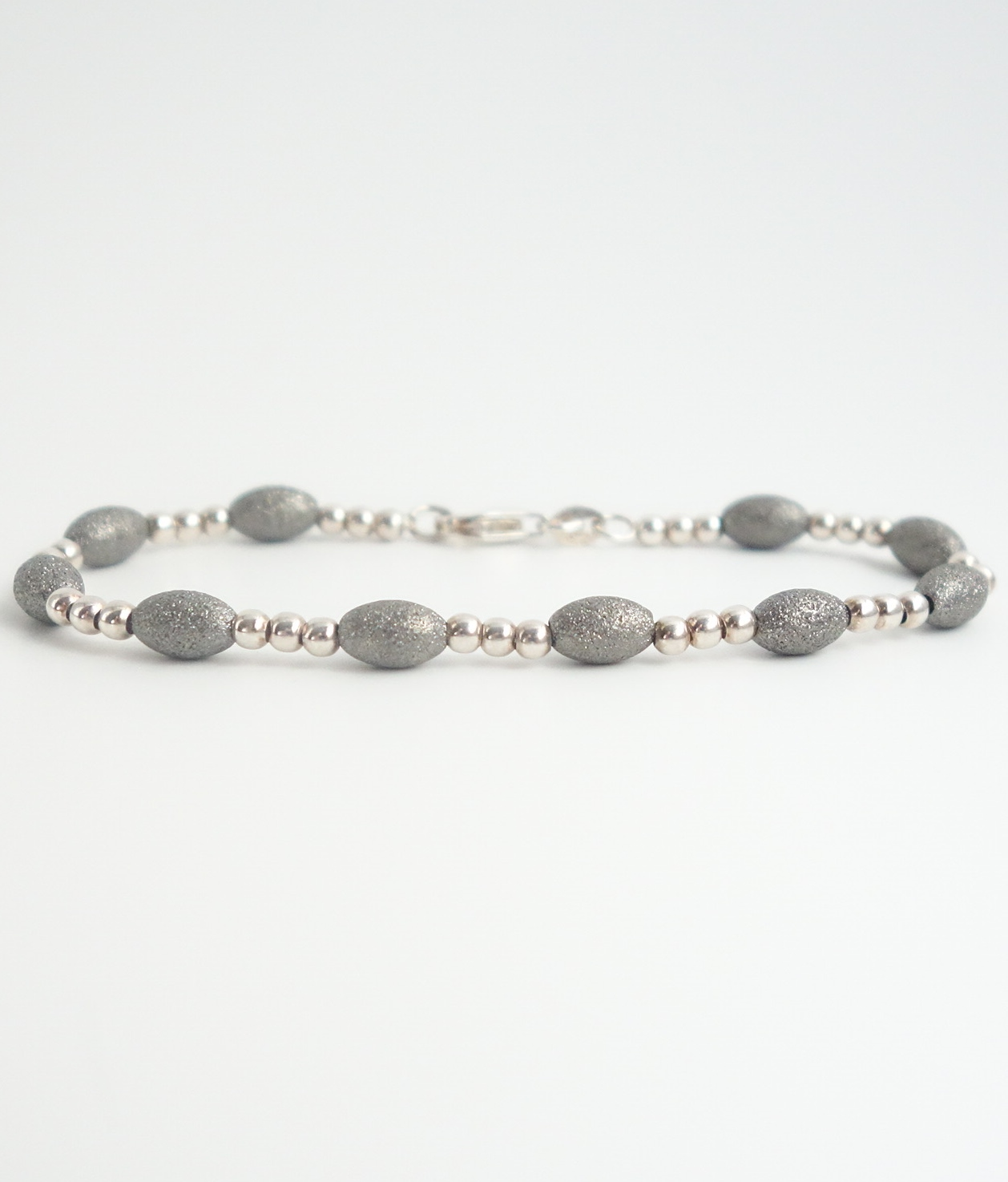 sterling silver beaded bracelet with dark grey sandblasted beads