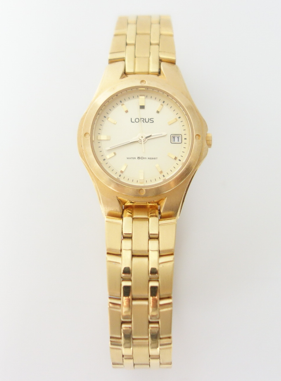 ladies lorus gold tone watch with date